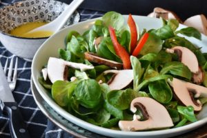 green leafy alkaline salad with mushrooms and spinach